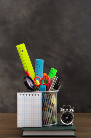 crayon  scissors: Stationery items and small notebook on table Stock Photo