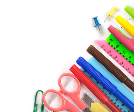 stationery items: Stationery items on notebook at right bottom corner on white