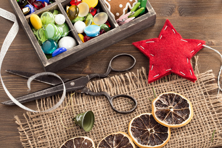 wood craft: Hand crafted holiday ornaments and vintage scissors top view