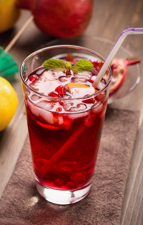 refreshing: Pomegranate with lemon and ice. Refreshing drink Stock Photo