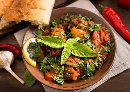 Chakhokhbili - traditional Georgian dish. Chicken stewed with herbs and tomatoes Фото со стока