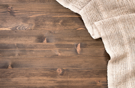 table wood: Gray handmade tablecloth from right side wooden table top view. Food background