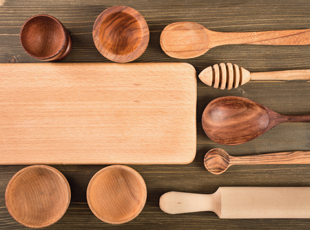cooking utensil: Empty  board and other kitchen utensils on wooden background top view