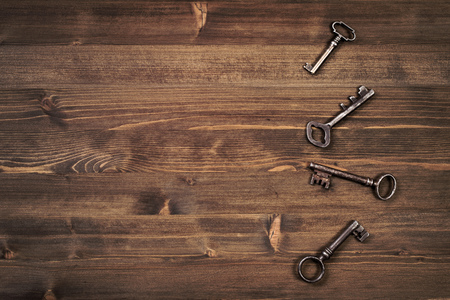 vintage objects: Old keys frm right side of wooden background top view Stock Photo