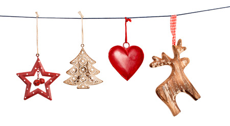 white background: Vintage Christmas decorations hanging on string isolated on white background
