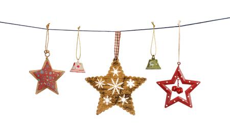 빈티지 크리스마스 별과 흰 배경에 고립 된 문자열에 매달려 종소리