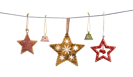 Vintage Christmas stars and bells hanging on string isolated on white background Stock Photo