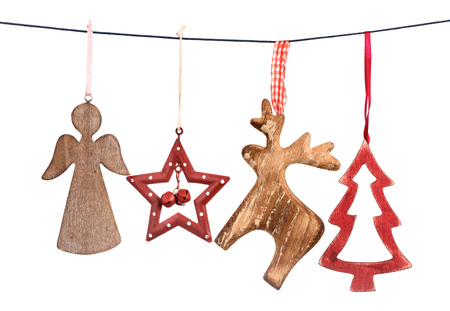 Old vintage Christmas decorations hanging on string isolated on white background