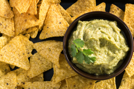 nacho chip: Homemade fresh guacamole sauce with corn chips top view