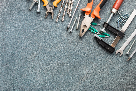 drill floor: Set of tools over gray stone texture background