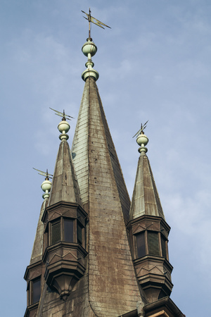 gabled houses: Medieval gabled roof of tower closeup.Toned Stock Photo