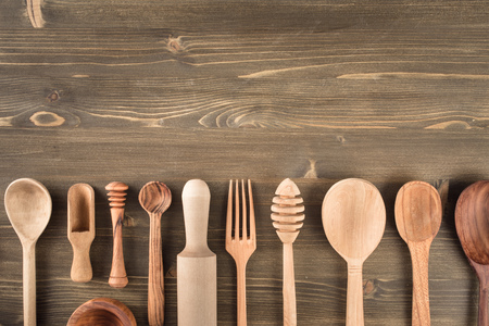 Various wooden kitchen utensils on table top view with copy space Stock Photo