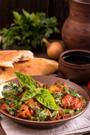 georgian: Chicken stewed with tomatoes and herbs. Traditional Georgian chakhokhbili Stock Photo