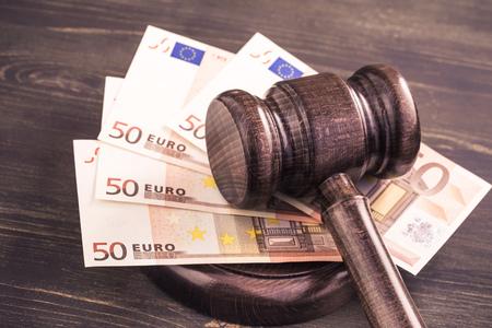 Mazo y algunos euros banknotes.Auction licitación, la corrupción del sistema judicial concept.Toned