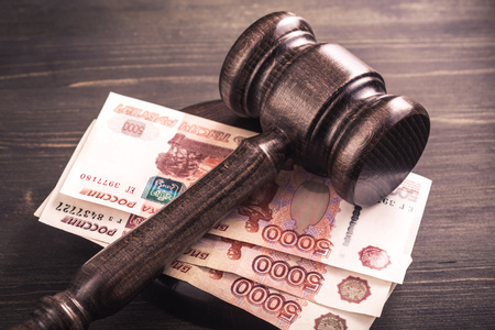 judicial: Gavel and some ruble banknotes.Auction bidding, judicial system corruption concept.Toned