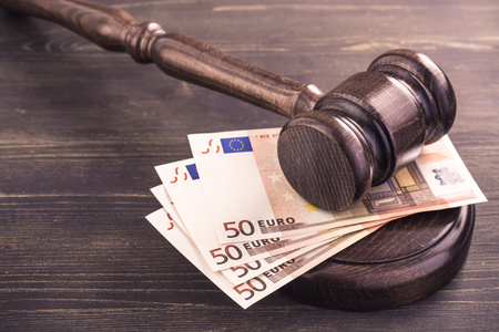 Gavel and four euro banknotes.Auction bidding, judicial system corruption concept.Toned