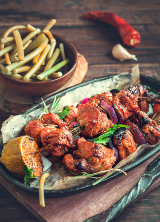 toned: Grilled pork skewers with ramson rustic. Toned