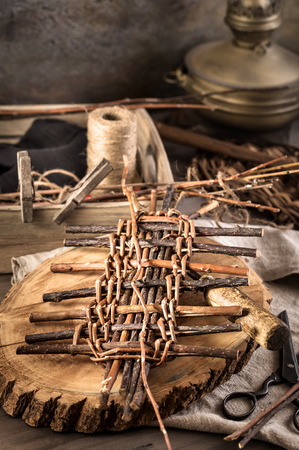 basket weaving: Vne stems and other items for basket weaving on table