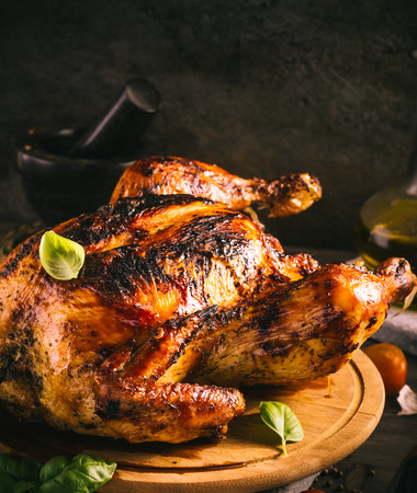 Grilled chicken on wooden plate rustic style