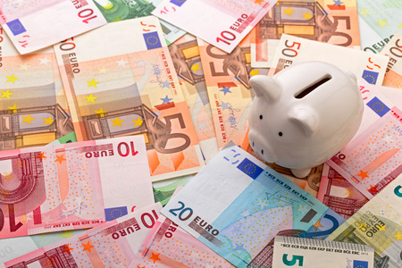 Piggy bank on euro banknotes background