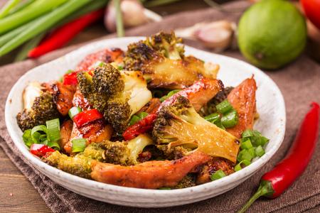 brocolli: Crispy chilli chicken with brocolli on plate