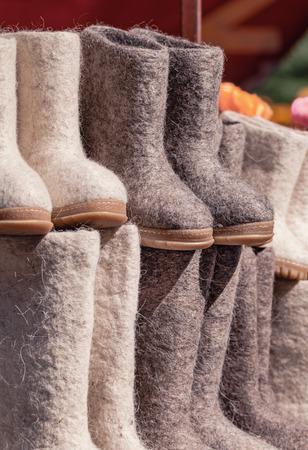 valenki: Felt boots on market stand. Valenki are traditional Russian winter footwear. Stock Photo