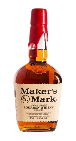 distilled: ORYOL, RUSSIA - SEPTEMBER 24, 2016: A bottle of Makers Mark Whiskey. Small-batch bourbon whiskey that is distilled in Kentucky. It is sold in squarish bottles, which are sealed with red wax. Editorial