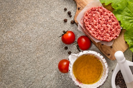 cooking oil: Raw beef meat steak cutlets on stone