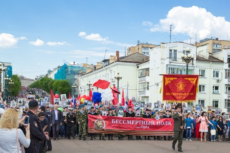 ORYOL, RUSSIA - MAY 09, 2016: The March of the Immortal Regiment in Oryol, people carry pictures of World War II soldiers.
