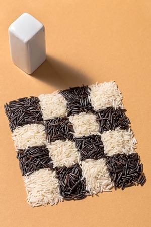 Black and white rice and rectangular salt shaker