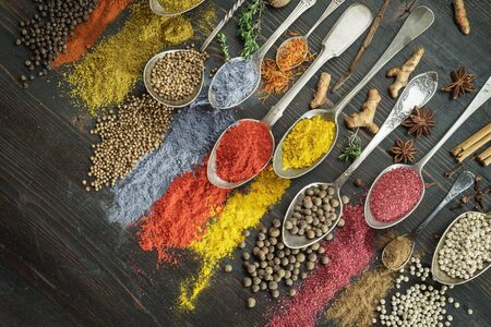 Spices on spoons with diagonal composition