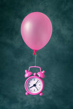 Alarm clock flying on balloon
