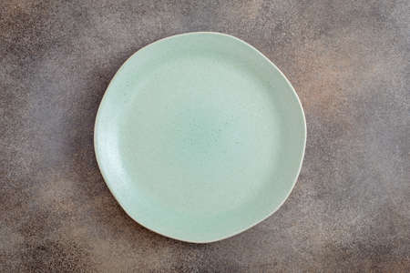 Empty green irregular plate above
