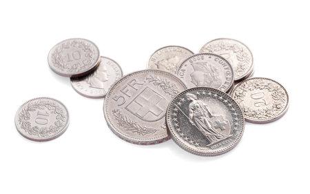 Modern swiss change coins on white