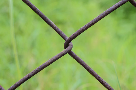 chained link fence: Wire netting or mesh fence Stock Photo