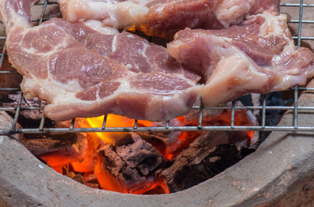 cattle grid: Steak pork on the grill, the combustion of charcoal Stock Photo