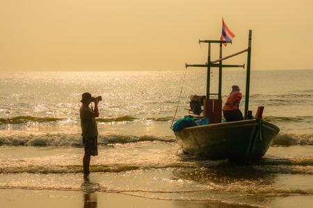 Sunset Coast fishermen and people photography