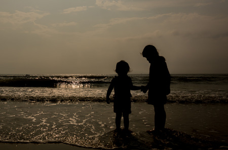 Silhouette photographed people on the beach