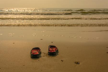 Sunset beach shoes Stock Photo