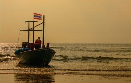 Small fishing boats parked at the beach in the evening