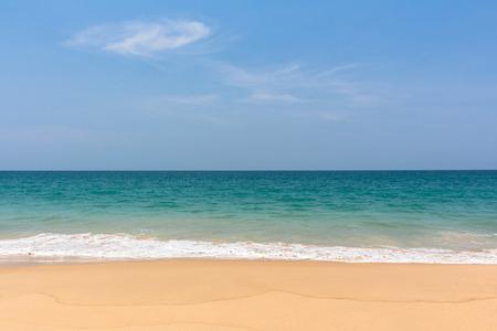 backgruond: Blue sky and the beach
