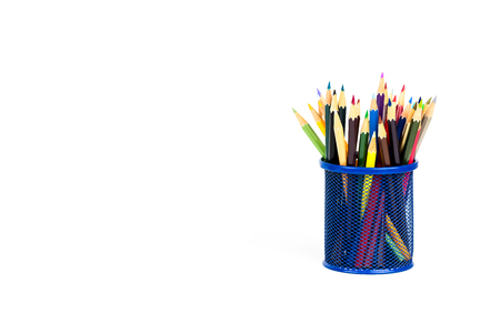 Color pencils in a pencil box on white background, back to school concept.