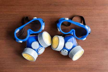 Respirator mask, dust mask  and safety mask for chemical industrial on wooden background.