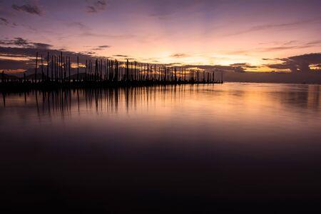 The Wood bridge on beach at sunrise in Phuket Thailand. Stock Photo