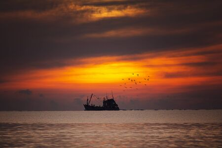 Fisherman boat in a beautiful view on the sea at sunrise