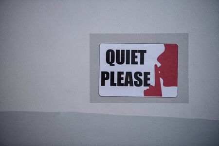 Quiet please sign on wall
