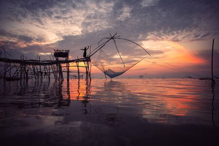 Beautiful nature of landscape morning sky at sunrise at fishing village lifestyle at at Baan Pak Pra is a famous landmark of Phatthalung, Thailand.