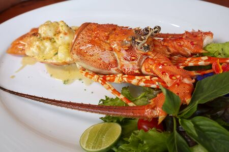 Baked Lobster on a white plate ,Luxury Seafood, Selective Focus of food. Stock Photo
