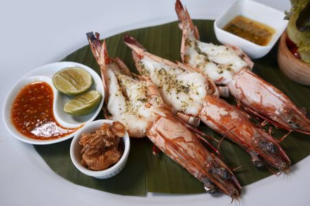 Grilled King prawns or shrimps with on white plate