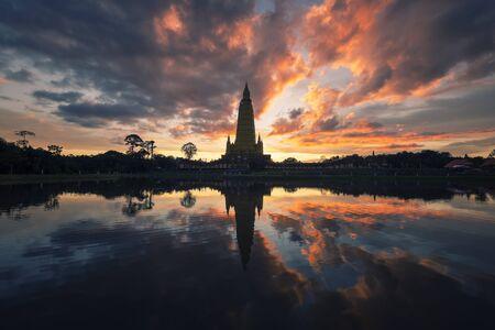 Beautiful nature with sunrise reflection on water at Wat Bang Thong